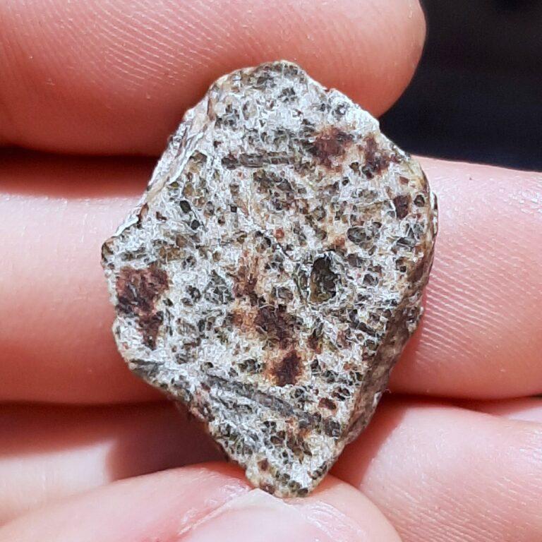 Erg Chech 002 meteorite. Oldest lava in Solar System. Endcut.