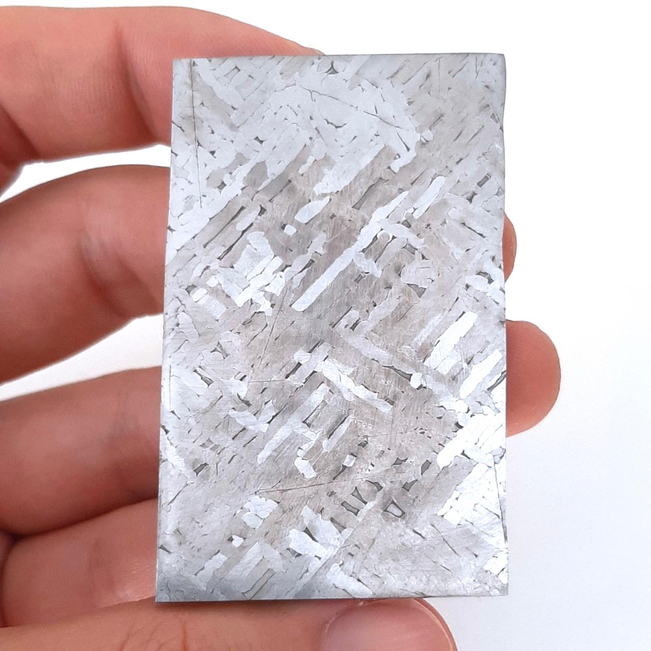 Cape York meteorite. 6x4 cm slice.